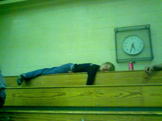 Michael Asleep in Bleachers