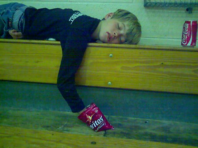 Boy Asleep with Dorito Bag